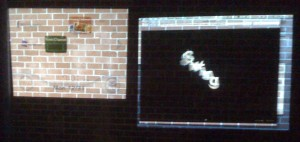 Swing projected on a brick wall next to the Wii menu